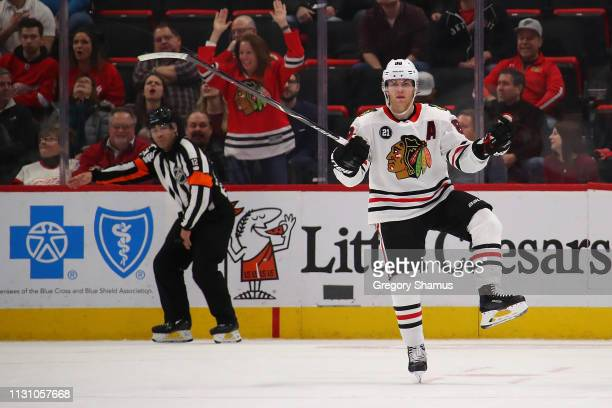 Patrick Kane of the Chicago Blackhawks celebrates his game winning overtime goal to beat the Detroit Red Wings 54 at Little Caesars Arena on February...