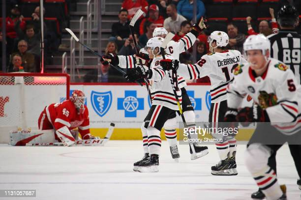 Patrick Kane of the Chicago Blackhawks celebrates his game winning overtime goal wth teammates to beat the Detroit Red Wings 54 at Little Caesars...