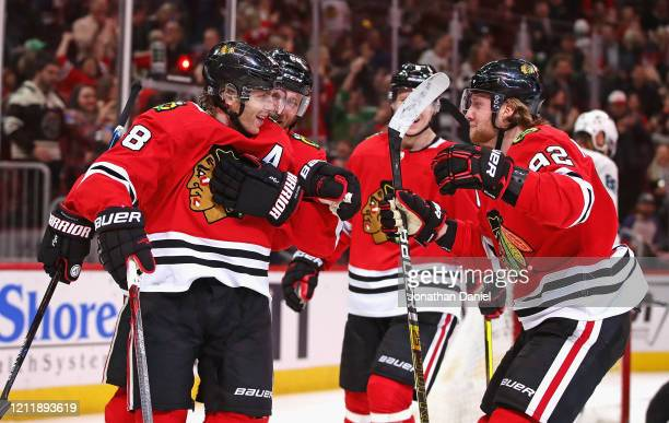 Patrick Kane of the Chicago Blackhawks celebrates his second goal of the game with Slater Koekkoek, Olli Maatta and Alex Nylander at the United...