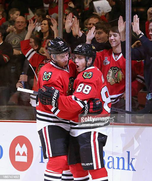 Patrick Kane of the Chicago Blackhawks celebrates his second period goal with Brandon Saad against the Calgary Flames at the United Center on...