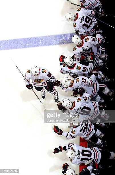 Patrick Kane of the Chicago Blackhawks celebrates his second period goal against the Winnipeg Jets with teammates at the bench at the Bell MTS Place...