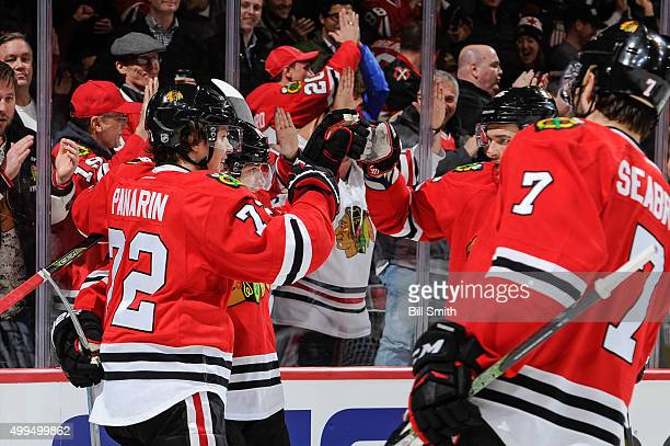 Patrick Kane of the Chicago Blackhawks celebrates with Artemi Panarin Artem Anisimov and Brent Seabrook after scoring against the Minnesota Wild in...