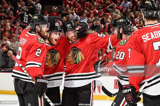 Patrick Kane of the Chicago Blackhawks celebrates with Duncan Keith, Brad Richards and Brandon Saad after scoring against the Anaheim Ducks in the...