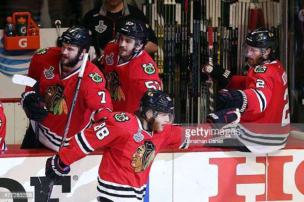 Patrick Kane of the Chicago Blackhawks celebrates with Duncan Keith after scoring a goal in the third period against the Tampa Bay Lightning during...