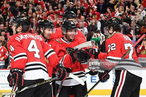 Patrick Kane of the Chicago Blackhawks celebrates with Duncan Keith and Artemi Panarin after assisting Panarin's goal to break the Chicago Blackhawks...