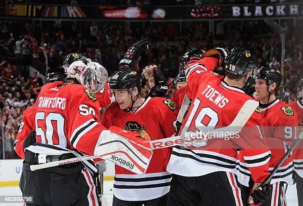 Patrick Kane of the Chicago Blackhawks celebrates with goalie Corey Crawford after the Blackhawks defeated the Nashville Predators 54 during the NHL...