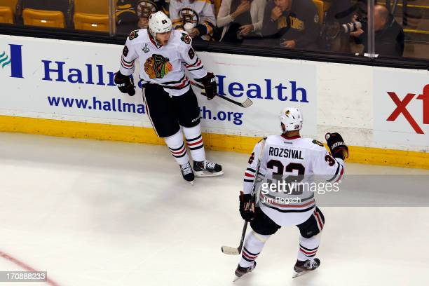 Patrick Kane of the Chicago Blackhawks celebrates with Michal Rozsival after Kane scores a goal in the second period against the Boston Bruins in...