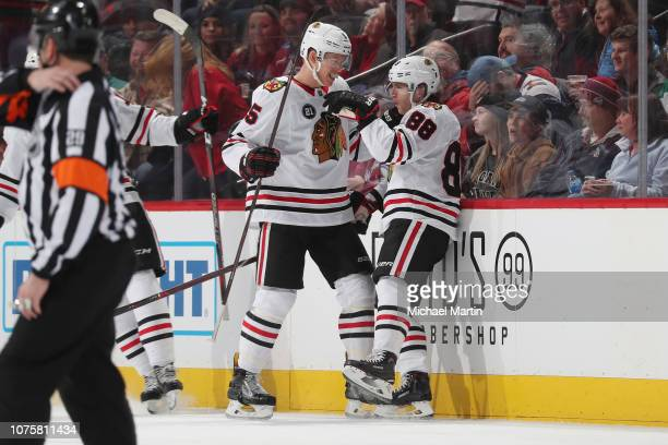 Patrick Kane of the Chicago Blackhawks celebrates with teammate Connor Murphy after scoring a goal against the Colorado Avalanche at the Pepsi Center...