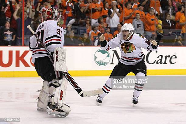 Patrick Kane of the Chicago Blackhawks celebrates with teammate Antti Niemi after scoring a goal in overtime to defeat the Philadelphia Flyers 4-3...
