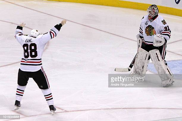 Patrick Kane of the Chicago Blackhawks celebrates with teammate Antti Niemi after scoring a goal in overtime to defeat the Philadelphia Flyers 43 and...