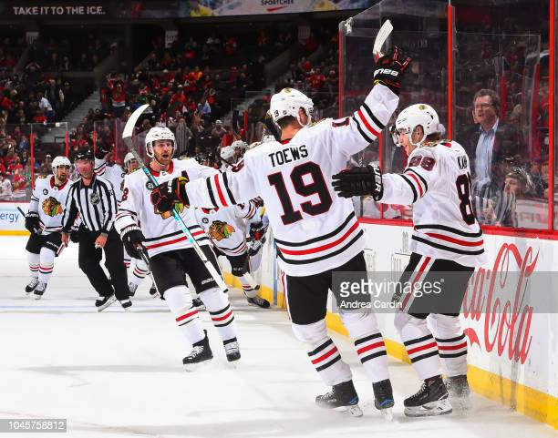 Patrick Kane of the Chicago Blackhawks celebrates with teammate Jonathan Toews after scoring an overtime goal on the Ottawa Senators at Canadian Tire...