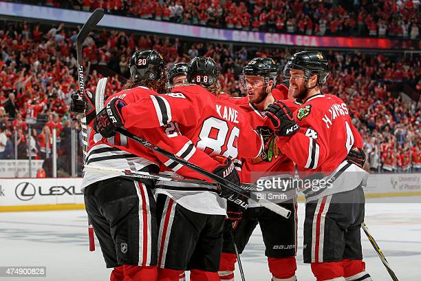 Patrick Kane of the Chicago Blackhawks celebrates with teammates, including Jonathan Toews and Niklas Hjalmarsson, after scoring against the Anaheim...