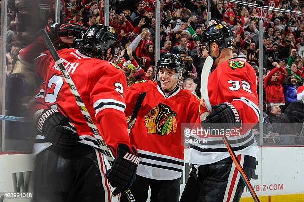 Patrick Kane of the Chicago Blackhawks celebrates with teammates after the Blackhawks scored against the Colorado Avalanche in the second period...