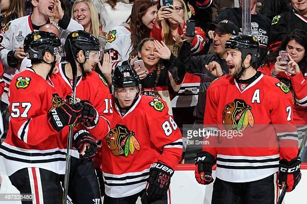 Patrick Kane of the Chicago Blackhawks celebrates with Trevor van Riemsdyk, Artem Anisimov and Brent Seabrook after scoring against the Calgary...