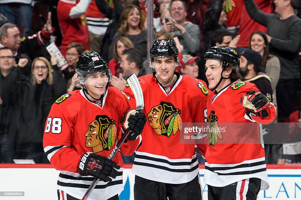 Patrick Kane #88 of the Chicago Blackhawks celebrates with Trevor van Riemsdyk #57 and Andrew Shaw #65 after he scored against the Dallas Stars in the third period of the NHL game at the United Center on February 11, 2016 in Chicago, Illinois.