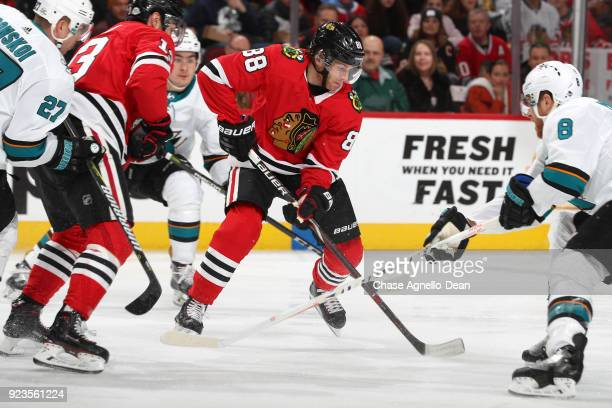 Patrick Kane of the Chicago Blackhawks chases the puck against the San Jose Sharks at the United Center on February 23 2018 in Chicago Illinois