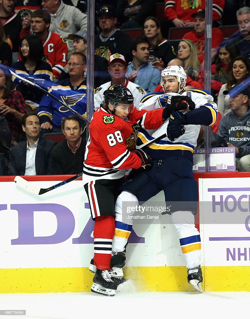 Patrick Kane #88 of the Chicago Blackhawks checks Alex Pietrangelo #27 of the St. Louis Blues into the boards at the United Center on November 4, 2015 in Chicago, Illinois.
