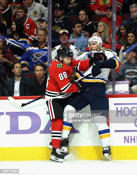 Patrick Kane of the Chicago Blackhawks checks Alex Pietrangelo of the St Louis Blues into the boards at the United Center on November 4 2015 in...