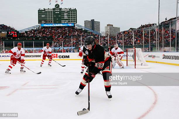 Patrick Kane of the Chicago Blackhawks controls the puck against the Detroit Red Wings during the NHL Winter Classic at Wrigley Field on January 1...