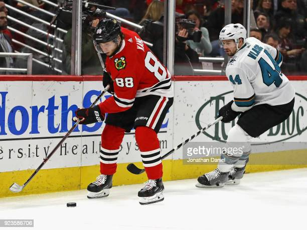 Patrick Kane of the Chicago Blackhawks controls the puck in front of MarcEdouard Vlasic of the San Jose Sharks at the United Center on February 23...