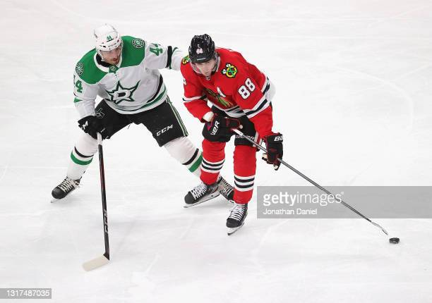 Patrick Kane of the Chicago Blackhawks controls the puck under pressure from Joel Hanley of the Dallas Stars at the United Center on May 10, 2021 in...