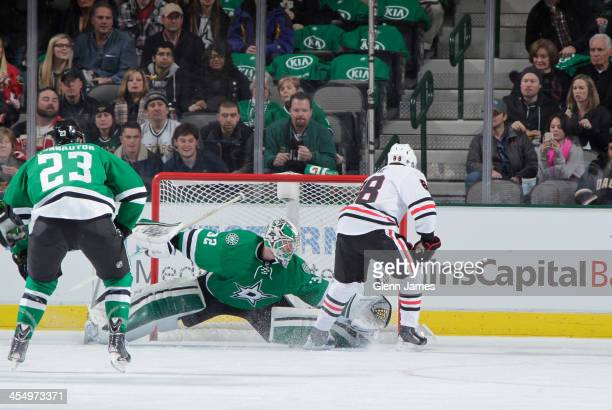 Patrick Kane of the Chicago Blackhawks flips a puck in over the glove of Kari Lehtonen of the Dallas Stars at the American Airlines Center on...