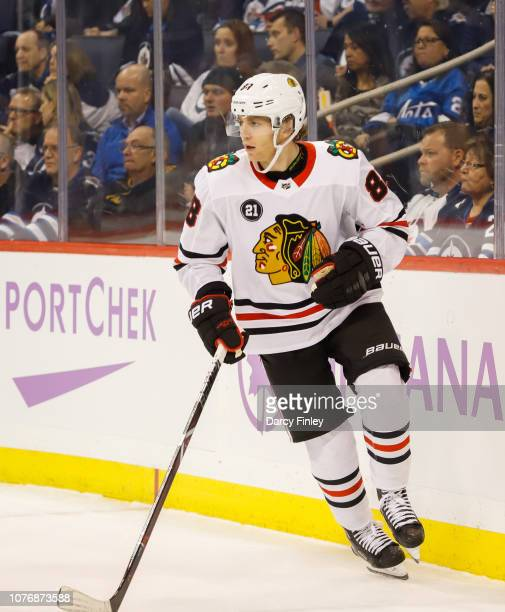 Patrick Kane of the Chicago Blackhawks follows the play around the boards during first period action against the Winnipeg Jets at the Bell MTS Place...