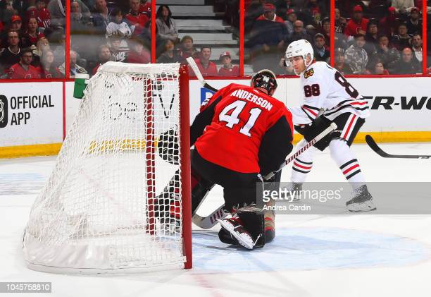 Patrick Kane of the Chicago Blackhawks gets the puck past Craig Anderson of the Ottawa Senators to score an overtime goal at Canadian Tire Centre on...