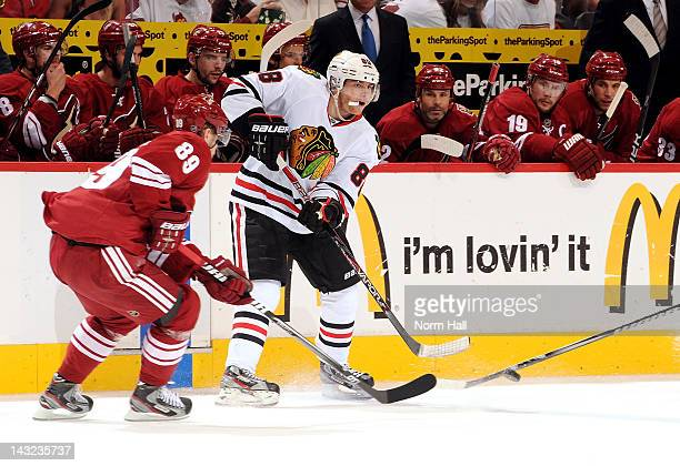 Patrick Kane of the Chicago Blackhawks gets the puck past Mikkel Boedker of the Phoenix Coyotes in Game Five of the Western Conference Quarterfinals...