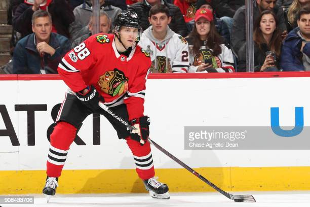 Patrick Kane of the Chicago Blackhawks grabs the puck in the second period against the Buffalo Sabres at the United Center on December 8 2017 in...
