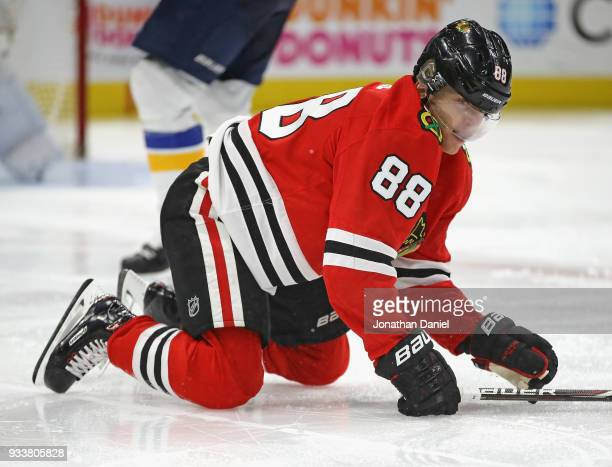 Patrick Kane of the Chicago Blackhawks hits the ice after colliding with Alexander Steen of the St Louis Blues at the United Center on March 18 2018...