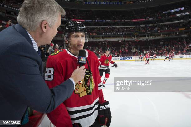 Patrick Kane of the Chicago Blackhawks is interviewed prior to the game against the New York Islanders at the United Center on January 20 2018 in...
