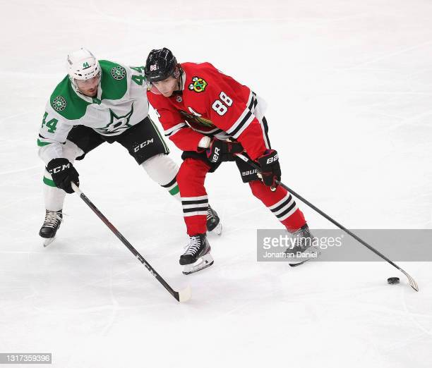 Patrick Kane of the Chicago Blackhawks is pressured by Joel Hanley of the Dallas Stars at the United Center on May 10, 2021 in Chicago, Illinois.