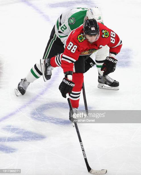 Patrick Kane of the Chicago Blackhawks is pressured by Radek Faksa of the Dallas Stars at the United Center on May 10, 2021 in Chicago, Illinois.