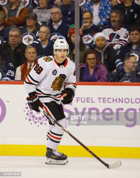 Patrick Kane of the Chicago Blackhawks keeps an eye on the play during first period action against the Winnipeg Jets at the Bell MTS Place on...