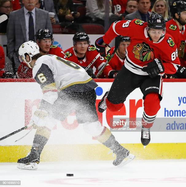 Patrick Kane of the Chicago Blackhawks leaps to avoid a collision with Colin Miller of the Vegas Golden Knights at the United Center on January 5...