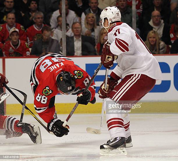 Patrick Kane of the Chicago Blackhawks leaves his feet next to Radim Vrbata of the Phoenix Coyotes in Game Four of the Western Conference...