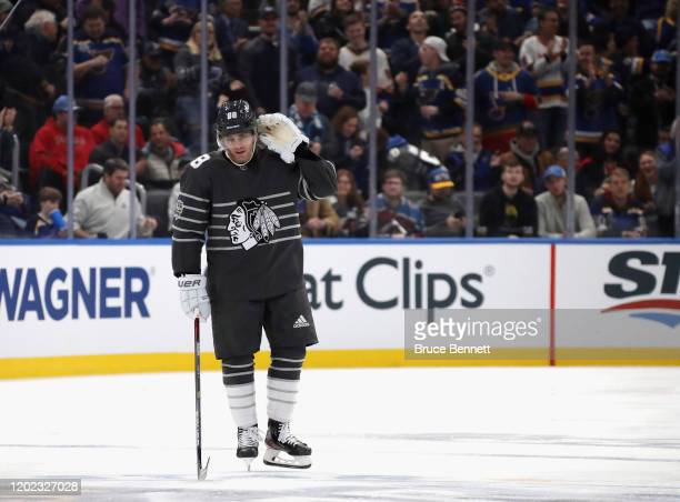 Patrick Kane of the Chicago Blackhawks listens for the fan reaction after scoring in the game between Pacific Division and Central Division during...