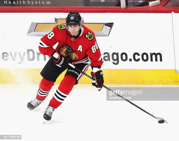 Patrick Kane of the Chicago Blackhawks looks to pass against the Dallas Stars at the United Center on May 09, 2021 in Chicago, Illinois. The...