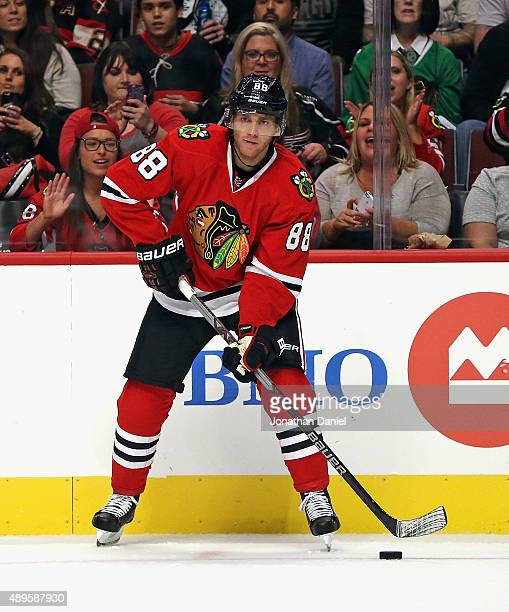 Patrick Kane of the Chicago Blackhawks looks to pass against the Detroit Red Wings during a preseason game at the United Center on September 22 2015...