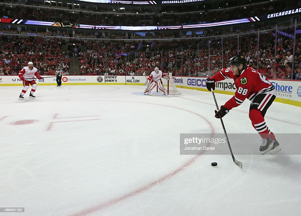 Patrick Kane #88 of the Chicago Blackhawks looks to pass against the Detroit Red Wings during a preseason game at the United Center on September 22, 2015 in Chicago, Illinois. The Blackhawks defeated the Red Wings 5-4 in overtime.