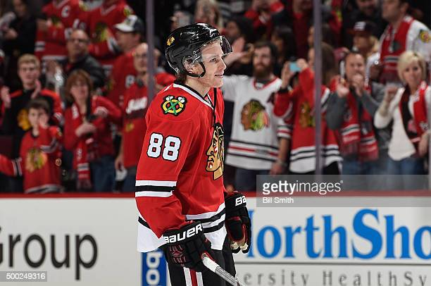 Patrick Kane of the Chicago Blackhawks looks toward his parents after breaking the Chicago Blackhawks consecutive points record with 22 after...
