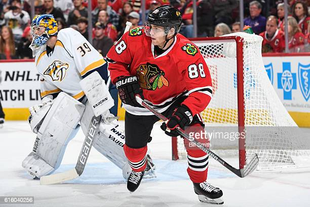 Patrick Kane of the Chicago Blackhawks looks up the ice next to goalie Marek Mazanec of the Nashville Predators in the first period at the United...