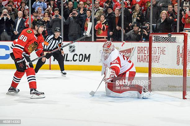 Patrick Kane of the Chicago Blackhawks misses his shootout shot against goalie Jimmy Howard of the Detroit Red Wings during the NHL game at the...