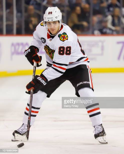 Patrick Kane of the Chicago Blackhawks plays the puck down the ice during third period action against the Winnipeg Jets at the Bell MTS Place on...