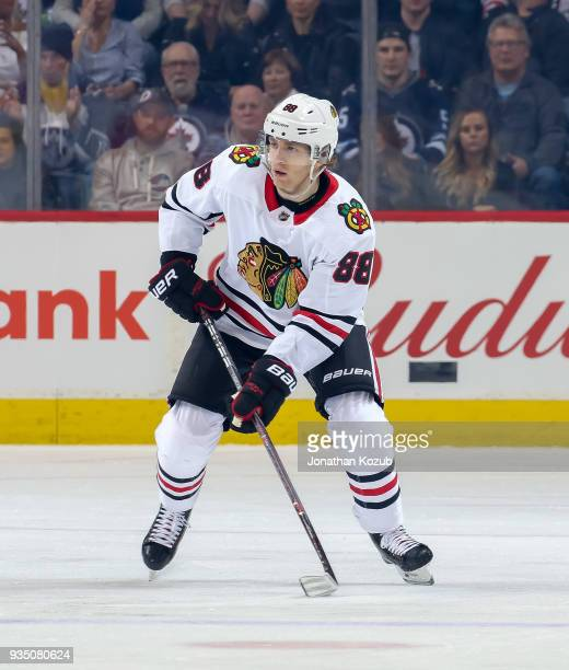 Patrick Kane of the Chicago Blackhawks plays the puck down the ice during first period action against the Winnipeg Jets at the Bell MTS Place on...