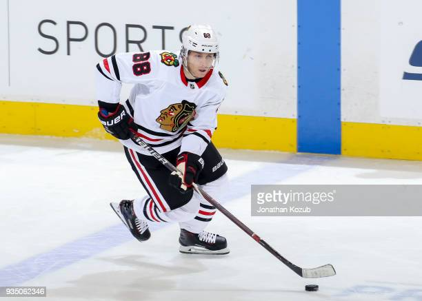 Patrick Kane of the Chicago Blackhawks plays the puck up the ice during third period action against the Winnipeg Jets at the Bell MTS Place on March...