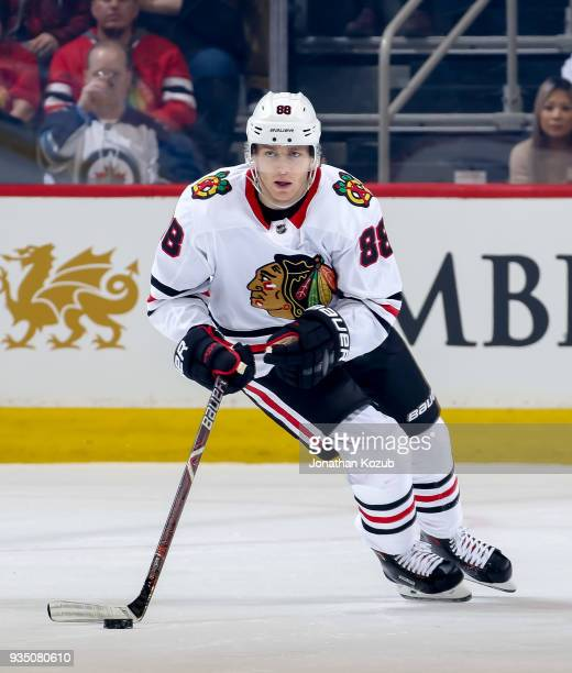 Patrick Kane of the Chicago Blackhawks plays the puck up the ice during first period action against the Winnipeg Jets at the Bell MTS Place on March...