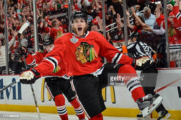 Patrick Kane of the Chicago Blackhawks reacts after scoring against the Boston Bruins in the first period in Game Five of the Stanley Cup Final at...