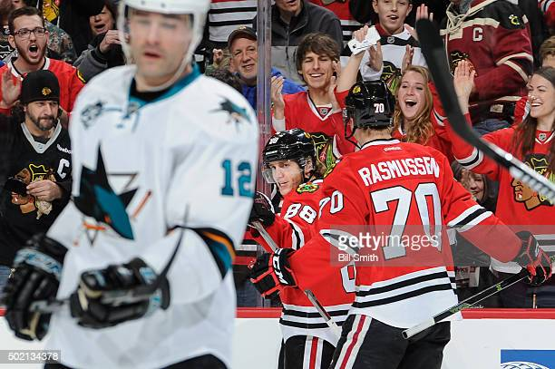 Patrick Kane of the Chicago Blackhawks reacts after scoring against the San Jose Sharks in the first period of the NHL game at the United Center on...